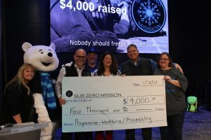 Progressive employees present check to sub zero mission board